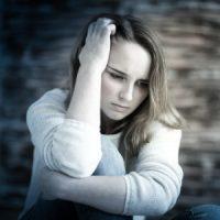 girl looking anxious and upset hand running through hair