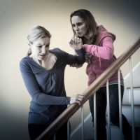 parent pushing away upset child