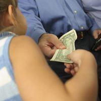 parent handing child money