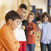 School child being bullied in school hallway