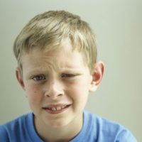 tween boy making funny face