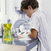boy doing his chores - washing the dishes