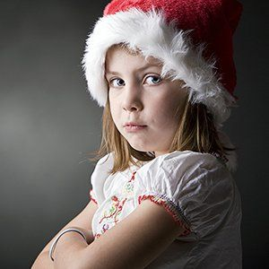 pouting child in Santa hat