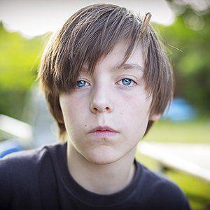 Pre-teen boy staring defiantly