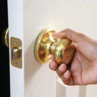 hand on a door nob of a parent